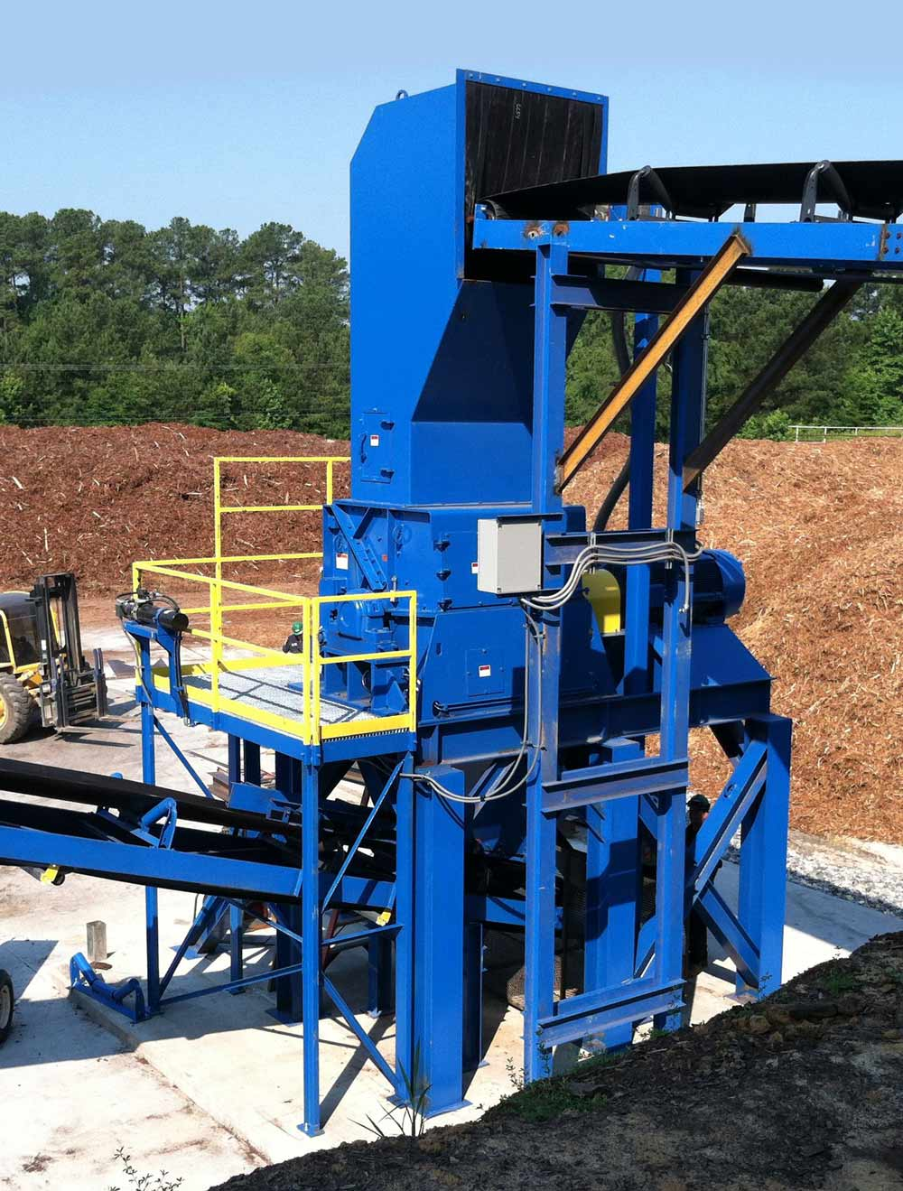 WSM Vertical Feed Grinder in the field